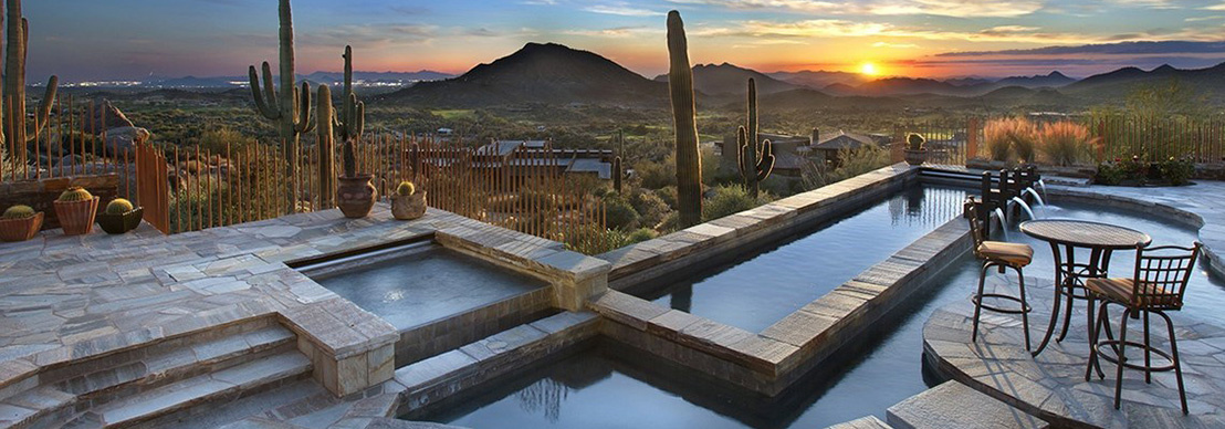 Sitting poolside at a luxury home for sale in Scottsdale Mountain area of Scottsdale AZ