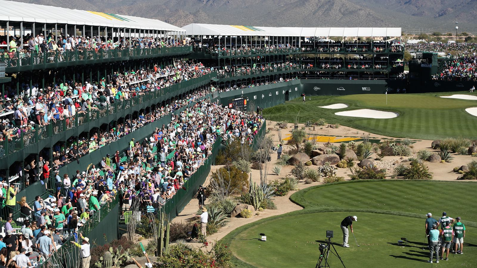 Golfer on the 16th hole of TPC Scottsdale, Phoenix Open, Scottsdale AZ