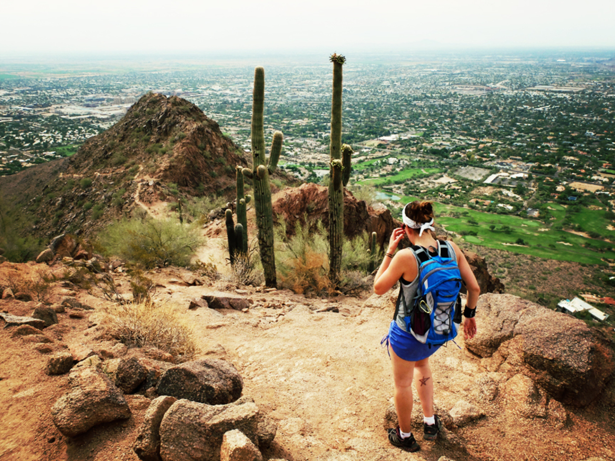 Hiker on top of Camelback Mountain in Scottsdale, AZ